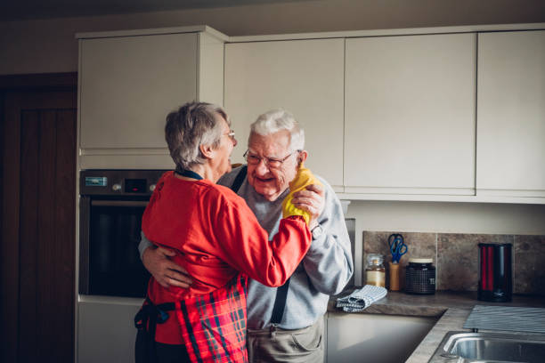 senior couple dance in their kitcchen - kitchen situations foto e immagini stock