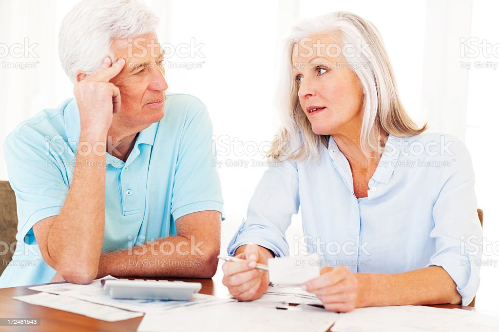 Senior Couple Discussing Financial Budget royalty-free stock photo