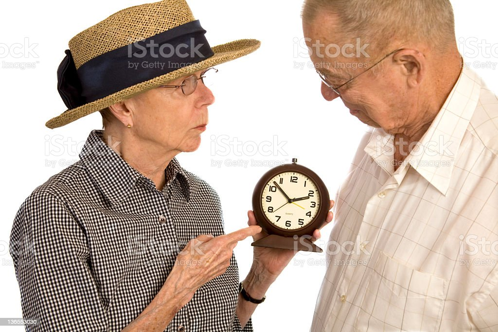 Senior couple discussing the Time stock photo