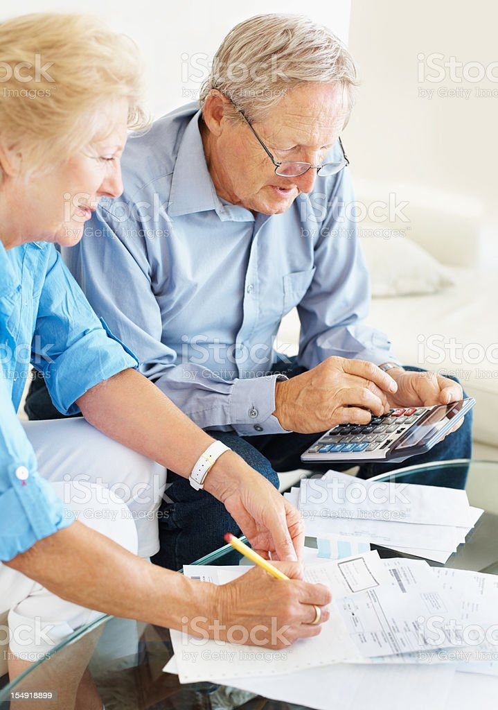 Senior couple discussing their financial budget at home royalty-free stock photo