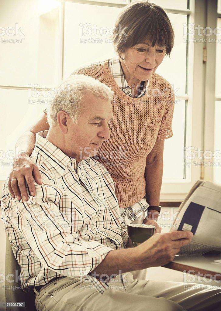 senior couple doing breakfast on the kitchen royalty-free stock photo