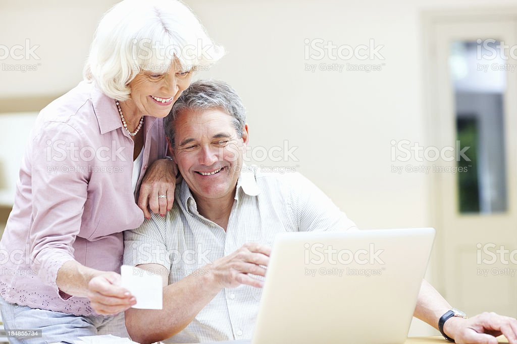 Senior couple doing paperwork together royalty-free stock photo