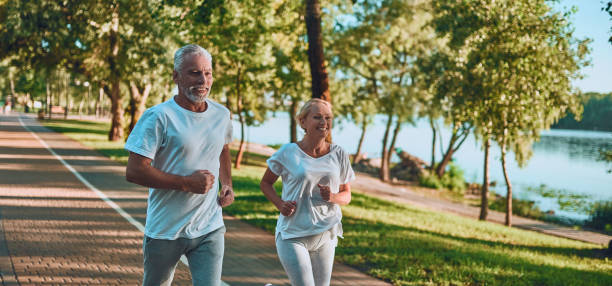 senior couple doing sport outdoors - midsection stock pictures, royalty-free photos & images