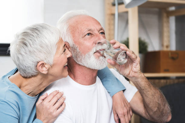 Senior couple drink water stock photo