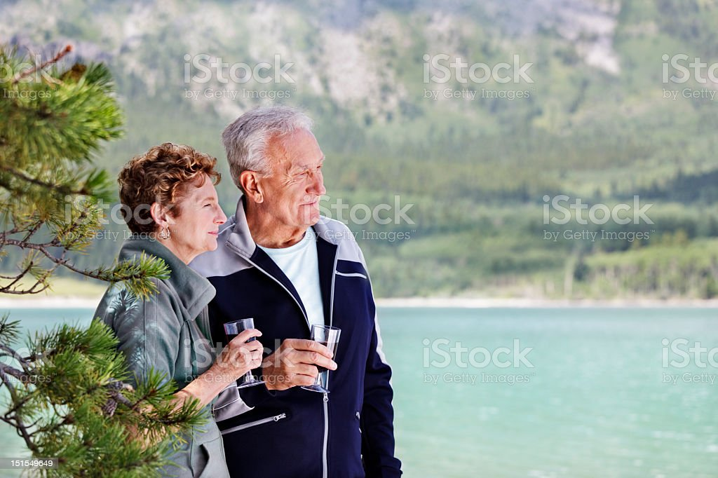 Senior couple drinking in the view stock photo