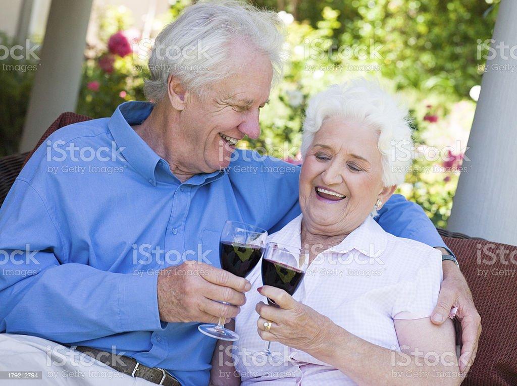 Senior couple drinking red wine royalty-free stock photo