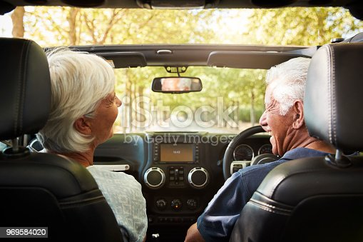 108329737istockphoto Senior Couple Drive Open Top Car On Countryside Road Trip 969584020