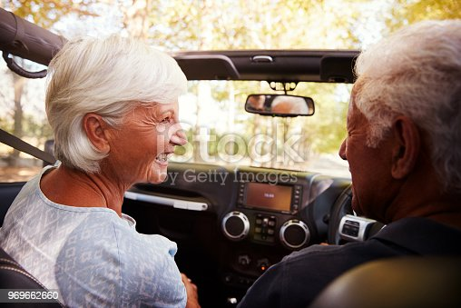 108329737istockphoto Senior Couple Drive Open Top Car On Countryside Road Trip 969662660