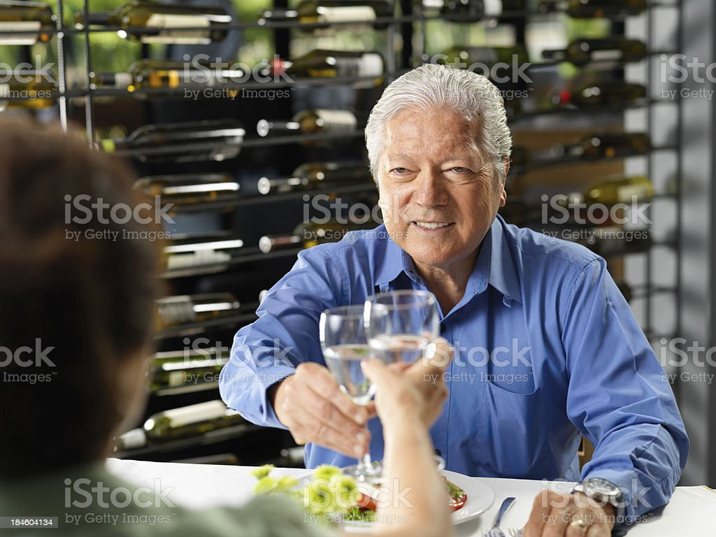 Senior couple eating at restaurant royalty-free stock photo