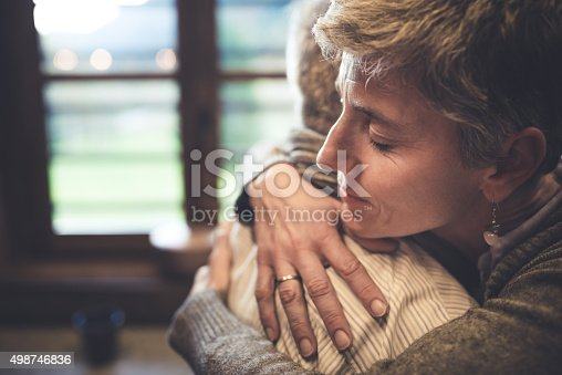 istock Senior couple embrace in kitchen 498746836
