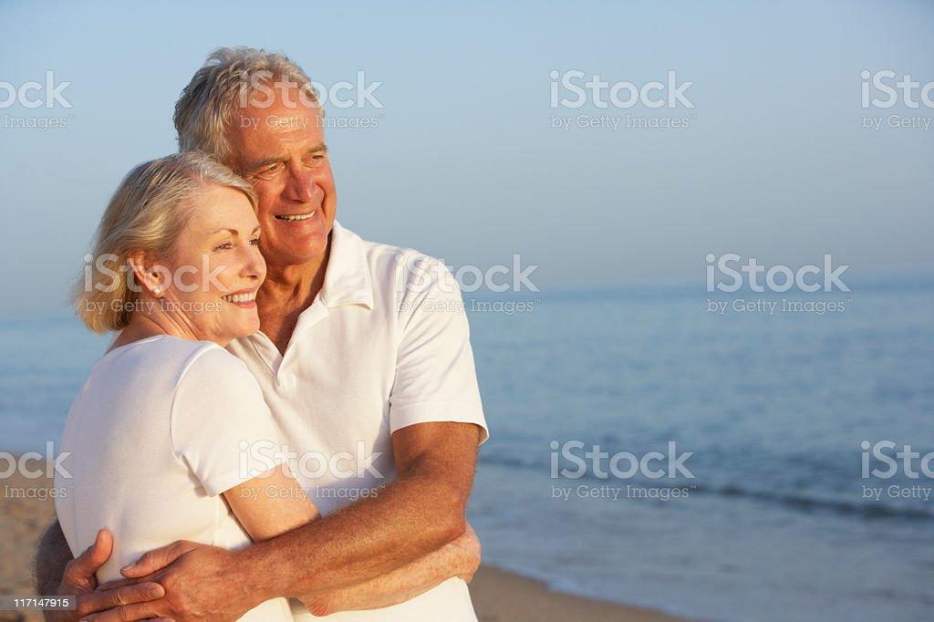 Senior couple embracing at a beach royalty-free stock photo