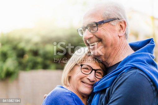 istock Senior couple embracing each other in backyard 541582194