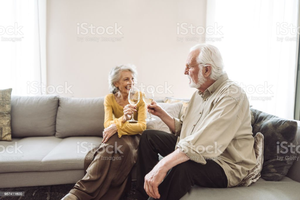 senior couple embracing in the living room