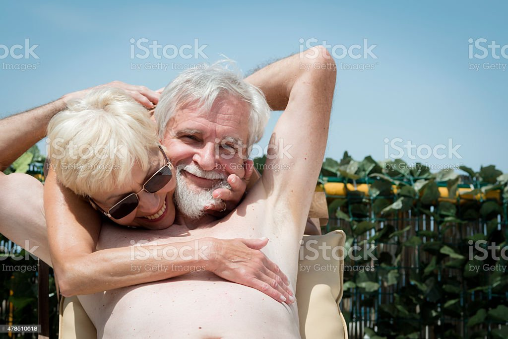 Happy Senior Woman Sunbathing On Summerterrace Portorose
