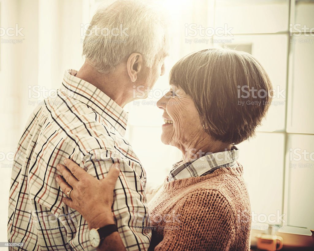 senior couple embracing passionate in the house royalty-free stock photo