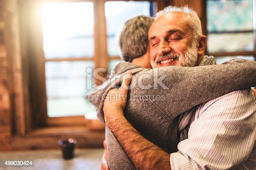istock senior couple embracing passionate in the house - support concept 499030424