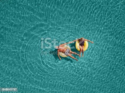 istock Senior couple enjoy sea water 848645792