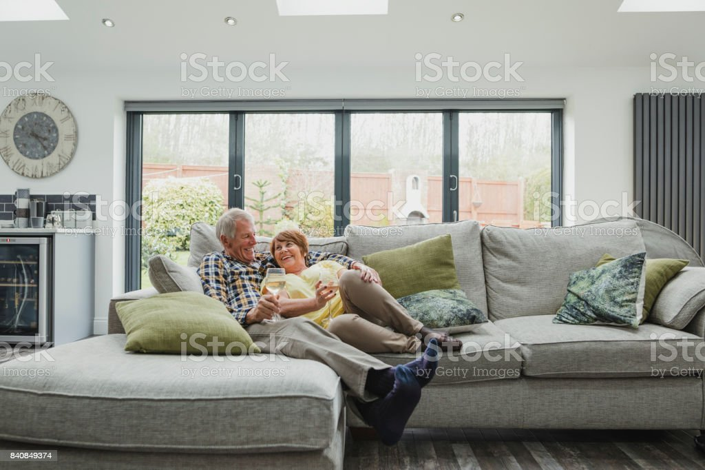 Senior Couple Enjoying A Glass At Home stock photo
