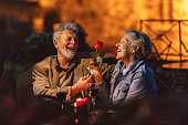 istock Senior couple enjoying a glass of wine 1188396853