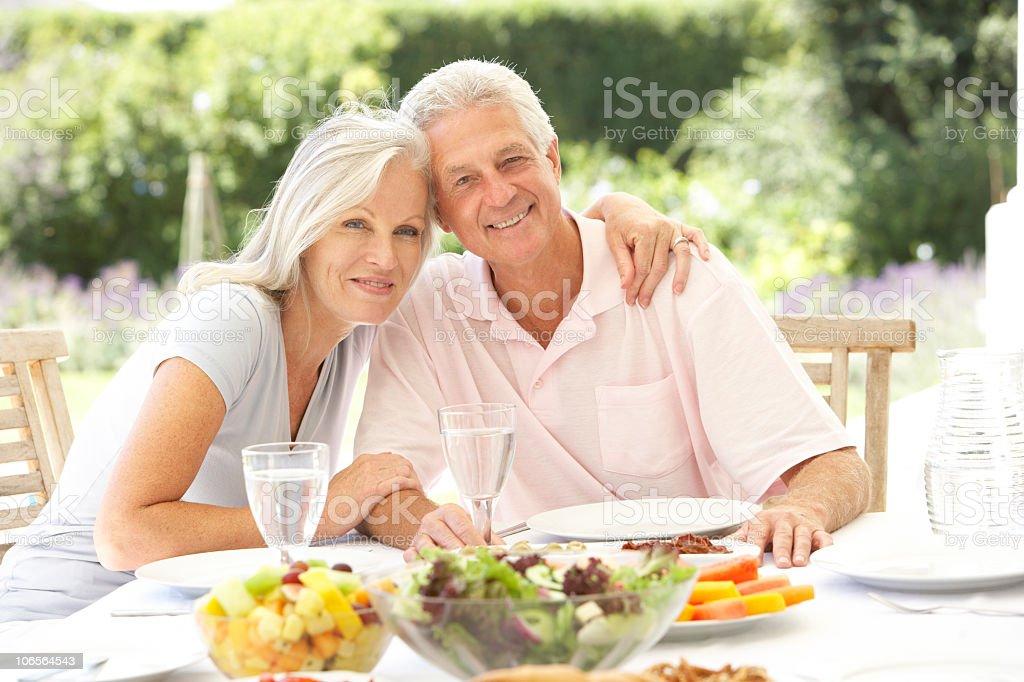 Senior couple enjoying al fresco meal royalty-free stock photo