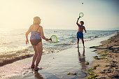 istock Senior couple enjoying beach paddle tennis 1169009834