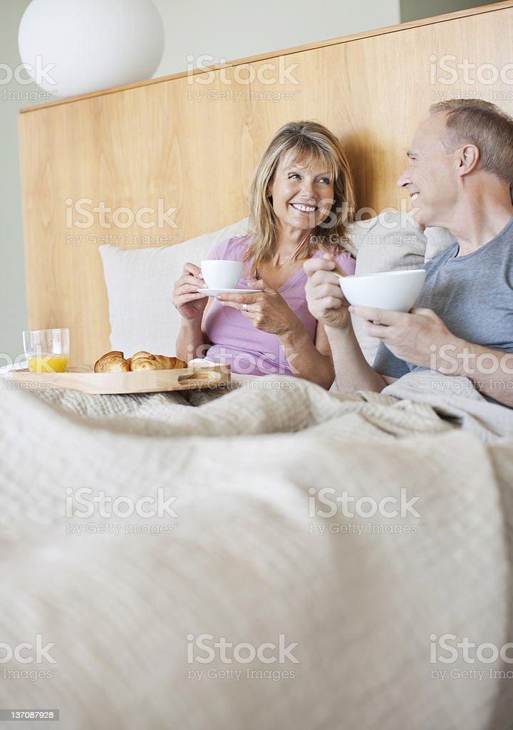Senior couple enjoying breakfast in bed royalty-free stock photo