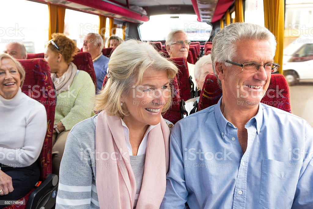 Senior Couple Enjoying Coach Journey stock photo