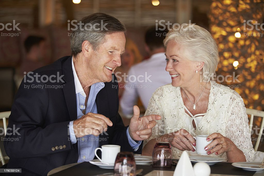 Senior Couple Enjoying Cup Of Coffee In Restaurant royalty-free stock photo
