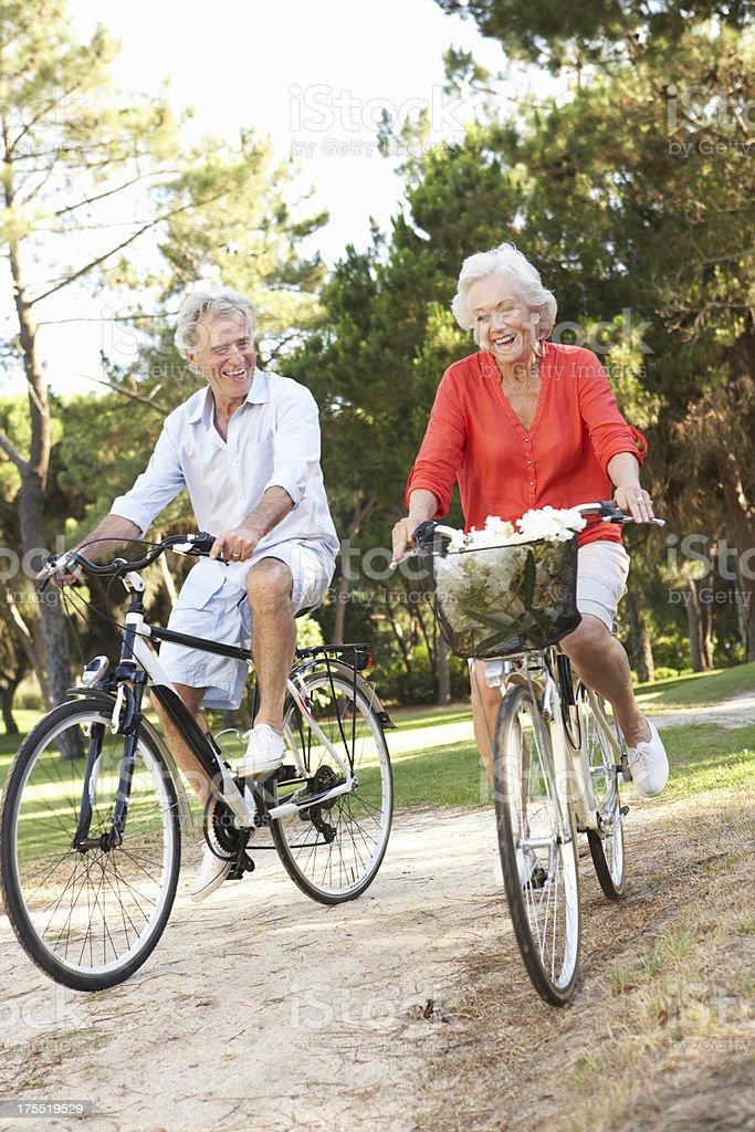 Senior Couple Enjoying Cycle Ride royalty-free stock photo