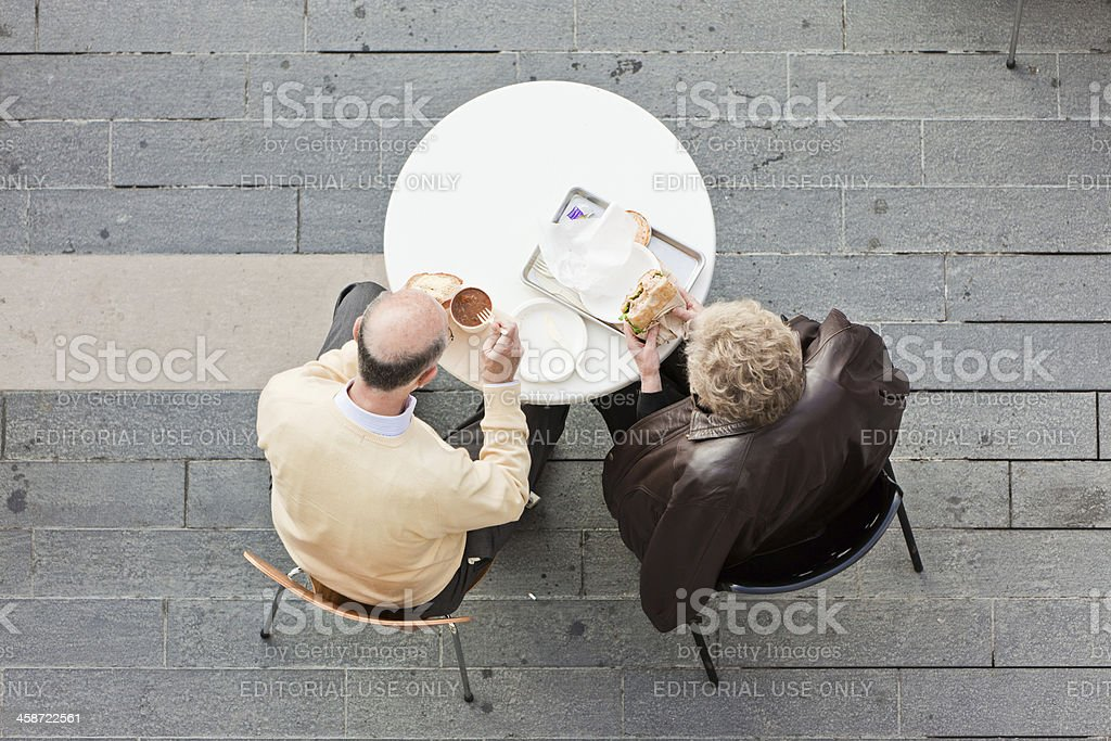 Senior couple enjoying food outdoor stock photo