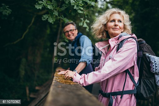 istock Senior Couple enjoying hike in the forest 611070262