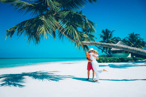 Senior couple enjoying holidays at Canareef Resort Maldives, Herathera island, Addu atoll - foto stock