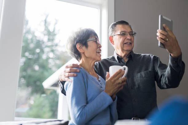 Senior couple enjoying morning coffee together stock photo