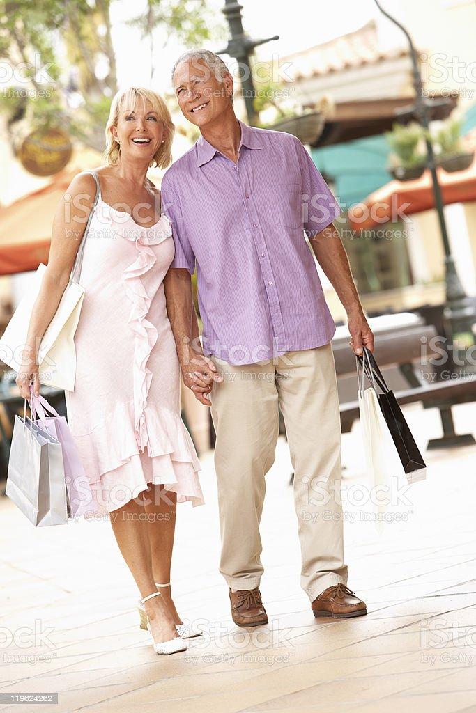 Senior Couple Enjoying Shopping Trip royalty-free stock photo