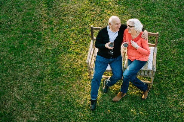 Senior couple enjoying the garden stock photo