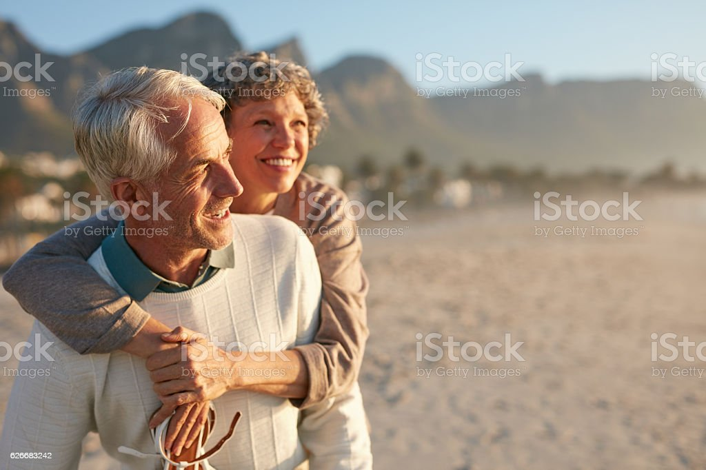 Senior couple enjoying their vacation at the beach stock photo