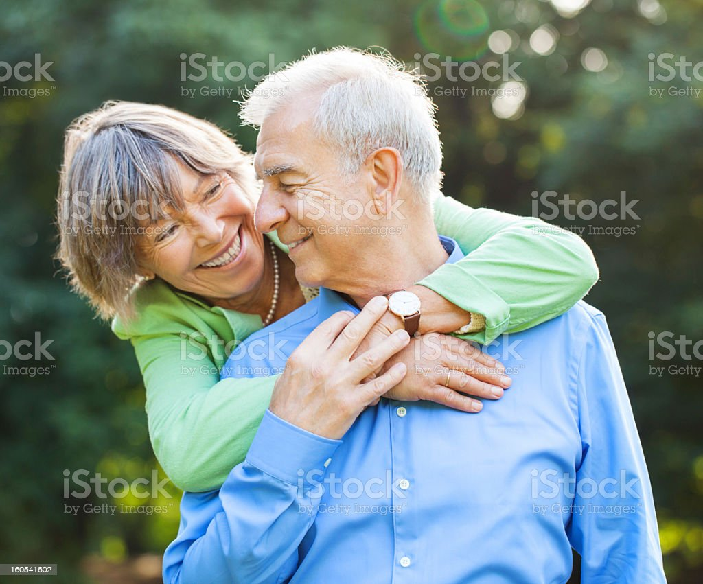 Senior couple enjoying time together at the park royalty-free stock photo