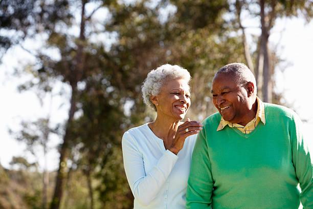 senior couple enjoying walk together - afroamerikanskt ursprung bildbanksfoton och bilder