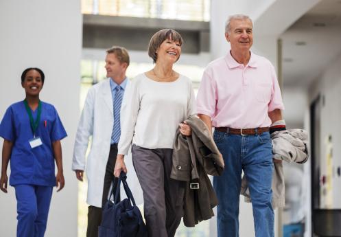 Senior Couple Entering Hospital Stock Photo - Download Image Now