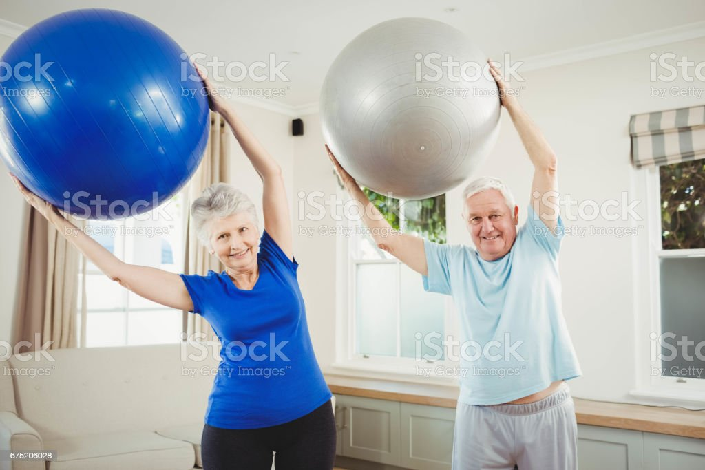 Senior couple exercising with exercise ball royalty-free stock photo