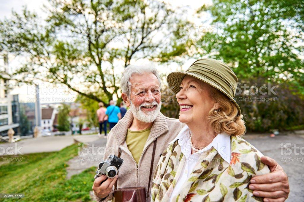 Senior couple exploring the city stock photo