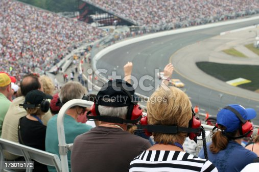 istock Senior Couple Fans at Racing Event 173015172