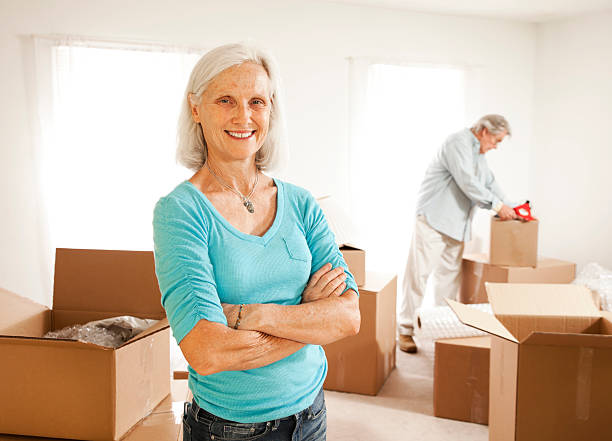 A senior couple filling up their boxes ready to move stock photo