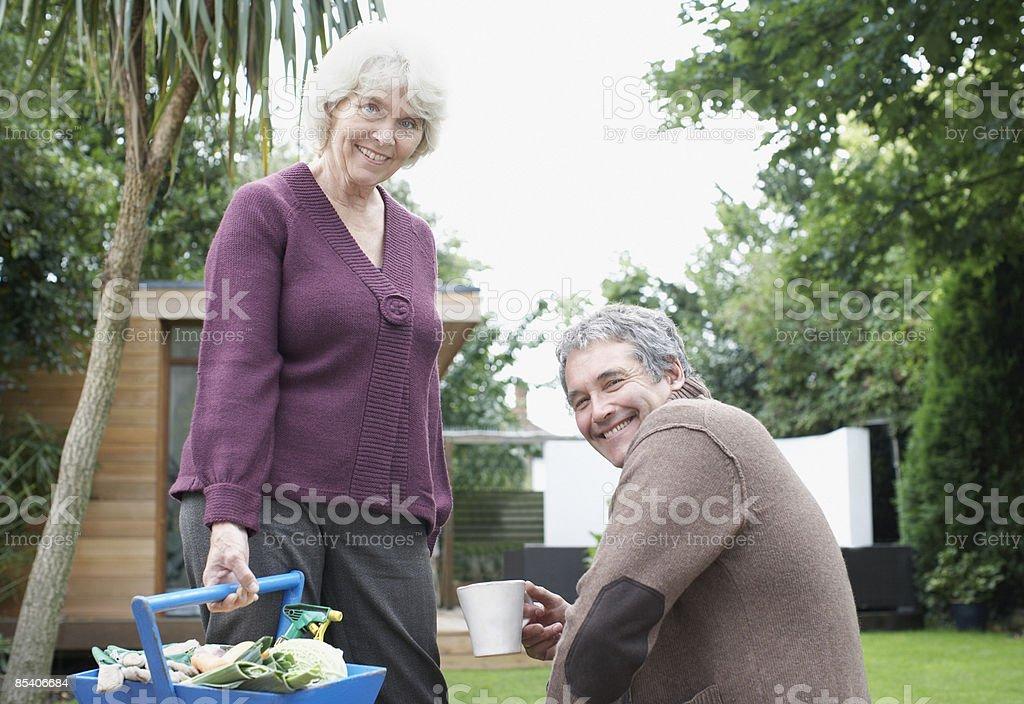 Senior couple gardening in backyard royalty-free stock photo
