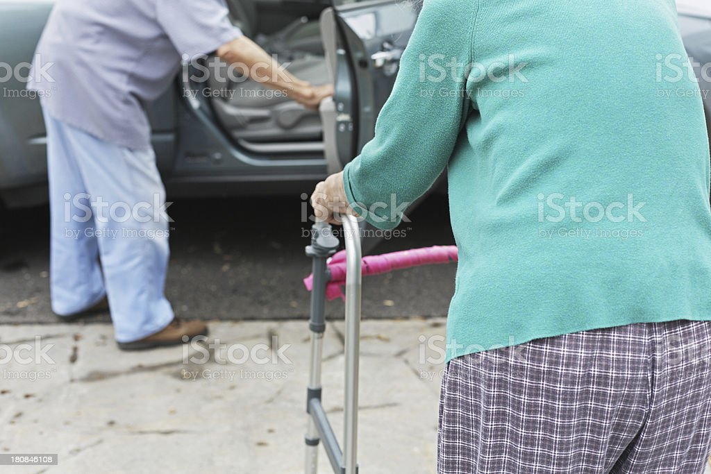 Senior Couple Getting Into Car royalty-free stock photo