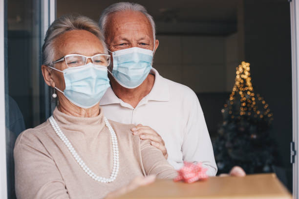 Senior couple getting present on Christmas stock photo