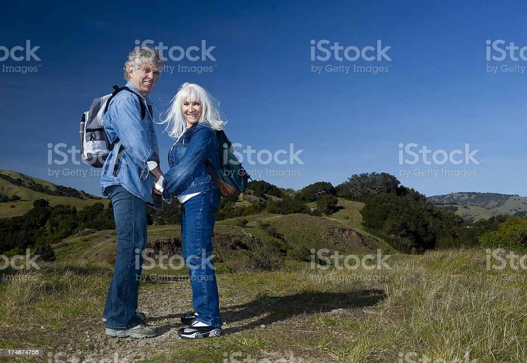 senior couple going for a walk royalty-free stock photo
