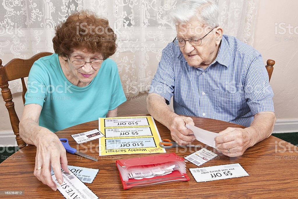 Senior Couple Going Through Coupons stock photo