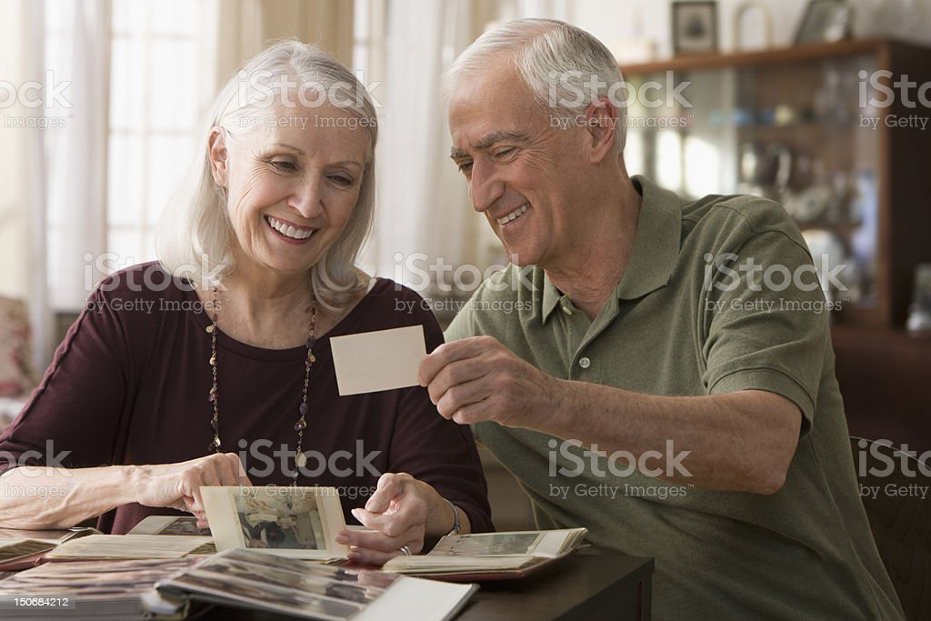 Senior couple going through photo album stock photo