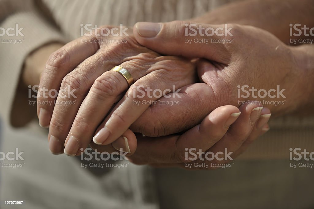 senior couple hands royalty-free stock photo